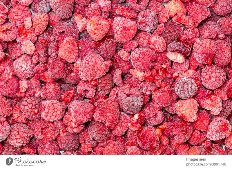 Frozen raspberries background Raspberry from on high backgrounds Berries Close-up Cold cold temperature color picture fruit Product Dessert top view Eating