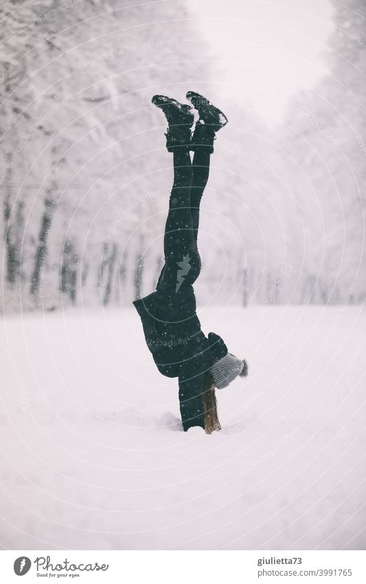 Sporty young woman in snowy park does handstand in the snow Winter Sports Snow Playing Exterior shot Joy White Cold Happy Infancy Seasons Vacation & Travel