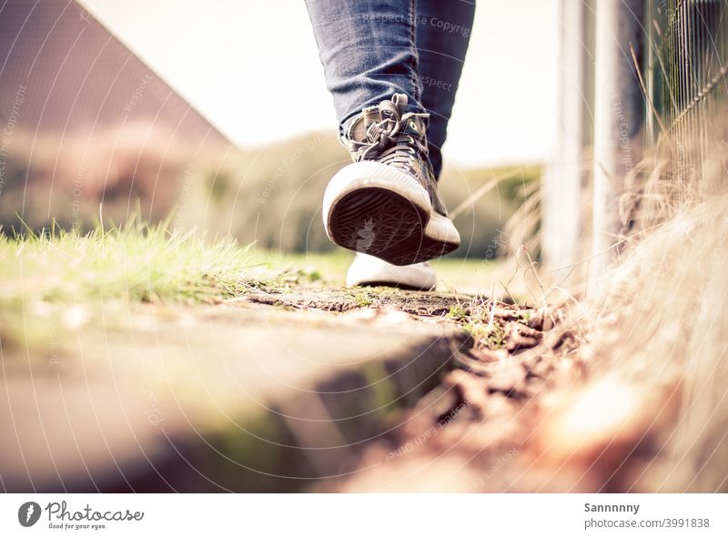 Cheerfully walking in sneakers on a railroad tie Footwear Walking Summer To go for a walk Happiness Feet Pedestrian Chucks Nature Running Ease Good mood out Hop