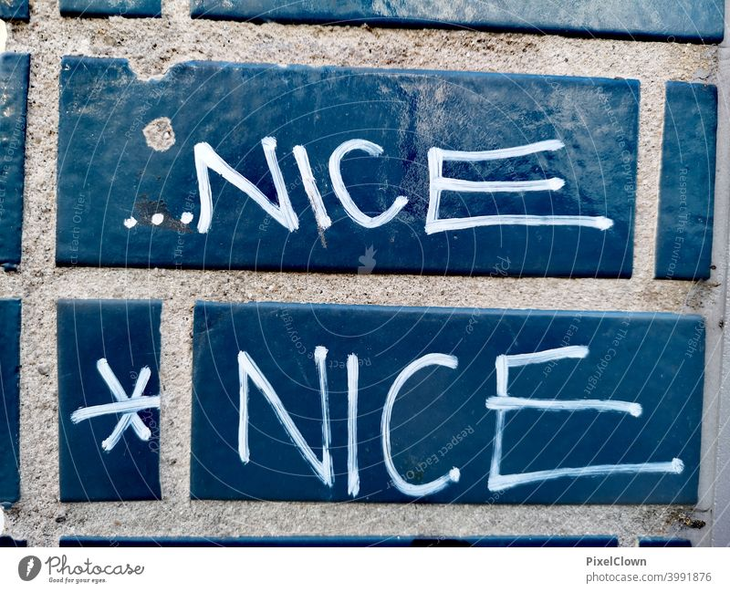 Graffiti, nice is always good Blue Wall (building) Colour photo Characters Street art Youth culture Word Daub Letters (alphabet) Subculture Trashy