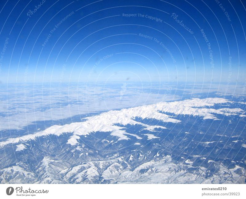 Winter from above Carpathians Aerial photograph Aviation Colour Snow Blue Sky Mountain