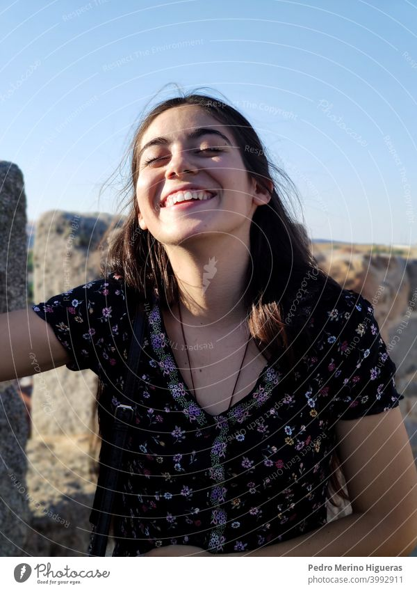 Girl smiling and laughing health life female outdoors dream summer caucasian joy person sky nature relax teenage lifestyle girl woman pretty fun vacation