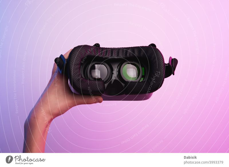 Virtual reality glasses in hand on colorful background. Future technology, VR concept vr headset virtual white helmet device game future video experience