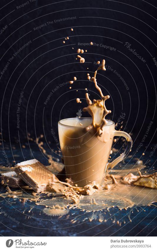 Splash of coffee with milk cup splash sweet fresh background drink black cool glass nobody beverage caffeine cold chocolate detail closeup cafe take flavor food
