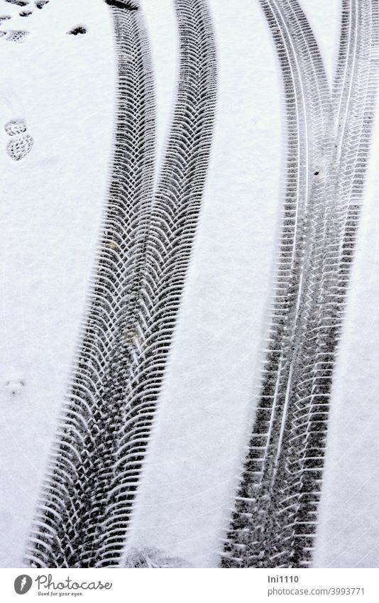 Traces of different tyre treads in the snow Tracks Profile Tire tread Snow disparate footprint Winter Fork Imprint structure Tyre print Cold Street snowy road