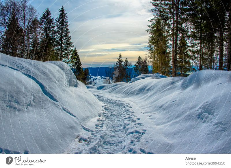 trail in the snow landscape rock valley nature outdoor mountain sky path scenery peak travel hiking blue hill alpine view range scenic panorama river background