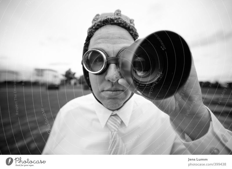 Man with aviator glasses uses lens as binoculars. He is wearing a shirt and tie. Office work Masculine Adults 1 Human being Media New Media Workwear Shirt Tie