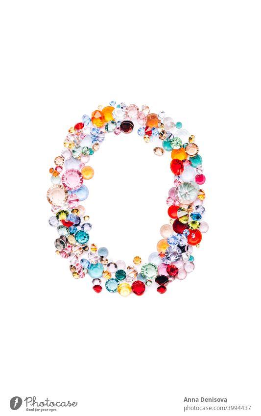 Letter O from glass bright gems gemstone letter font text alphabet jewel artificial crystal sparkle zirconia blue treasure precious diamond green jewelery