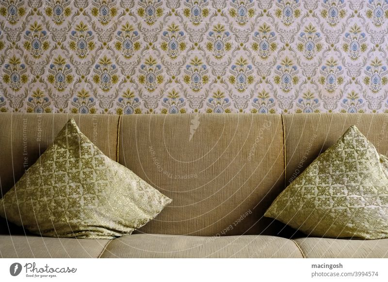 Old sofa with sofa cushions and pattern wallpaper. Sixties Gelsenkirchen Baroque Old fashioned stale german residential culture 1960s 1970s Seventies square