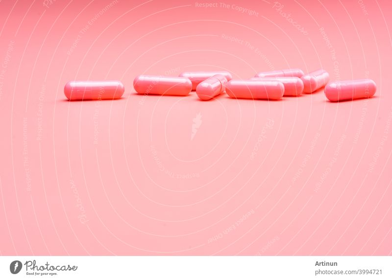 Pink capsule pills on pink background. Valentine's day concept. Pills of love. Treatment and care for love. Happy Valentine's day. Pharmacy background. Pharmaceutical industry. Health and medicine.