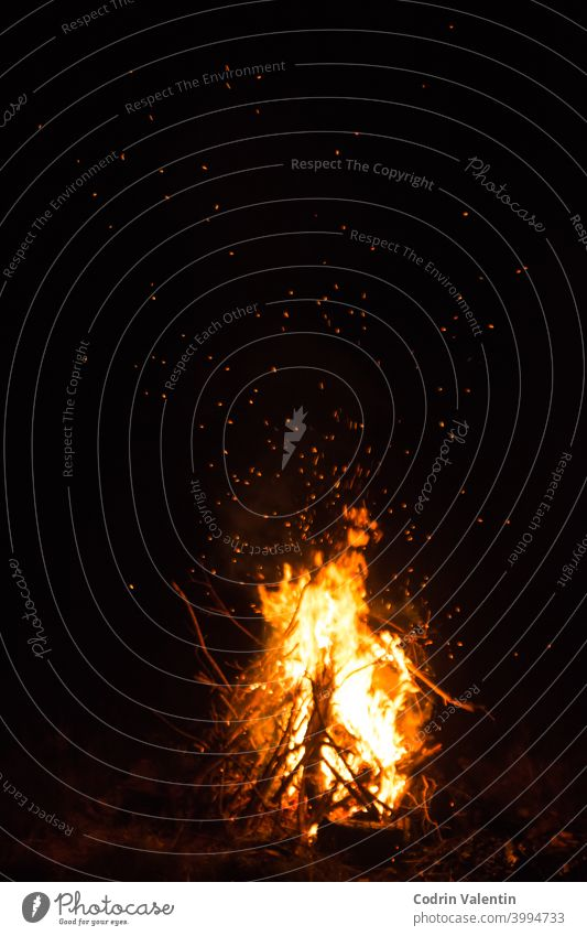 Firecamp at the night time. Hot fireplace full of wood and fire burning, closeup abstract amber arrow art ash bonfire burnt campfire cooking dark energy flame