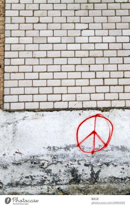 Peace on earth, pleace. peaceful peace sign Peaceful Harmonious Peace Symbols Wall (barrier) Wall (building) Facade Building stone Graffiti Characters Sign