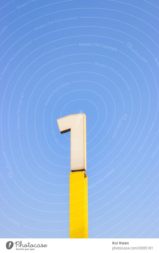Number 1 ; number one sign in yellow ; with plain blue sky Numbers Number one Digits and numbers Characters Minimalistic minimalism 123 one and only Mathematics