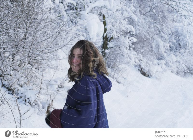 Young woman with warm clothes, laughing, snow in background. one person young adult Girl Youth (Young adults) Feminine portrait pretty Fresh naturally Authentic