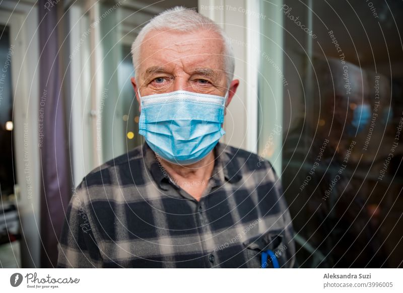 Senior man in protective mask staying home during pandemic lockdown. adult aged assistance breathing care coronavirus covid-19 disease distance elderly epidemic
