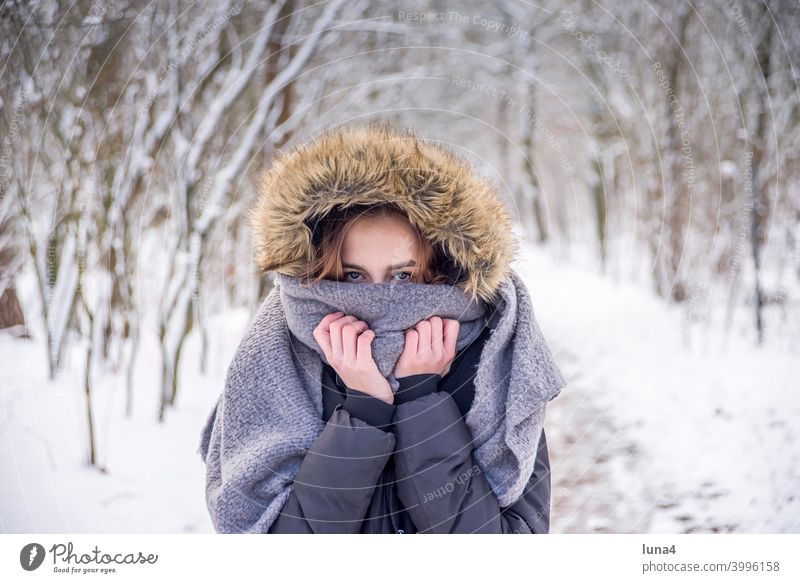 Girl freezes in winter forest Winter Snow Forest Freeze Scarf Winter forest Cap Hooded (clothing) Frost Cold Earnest Tree chill Youth (Young adults)