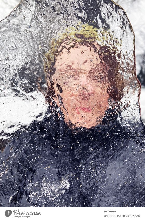 Woman looking through ice floe Vista hazy Eyes Face Human being Adults 1 Feminine Looking Transparent Looking into the camera Head Day Colour photo Winter Ice