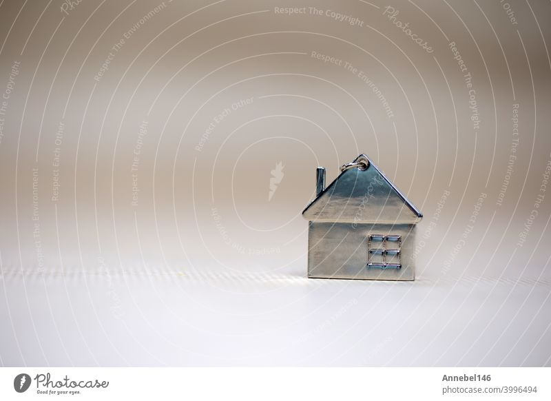 Little miniature house on blurred background, New home, Real Estate, Mortgage loan,architectural concept with Copy space little copy space symbol family love