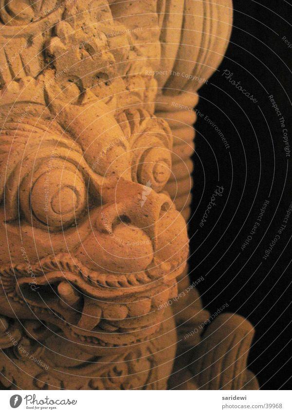 Old Black Stone Obscure Deities Bali Indonesia Stone statue
