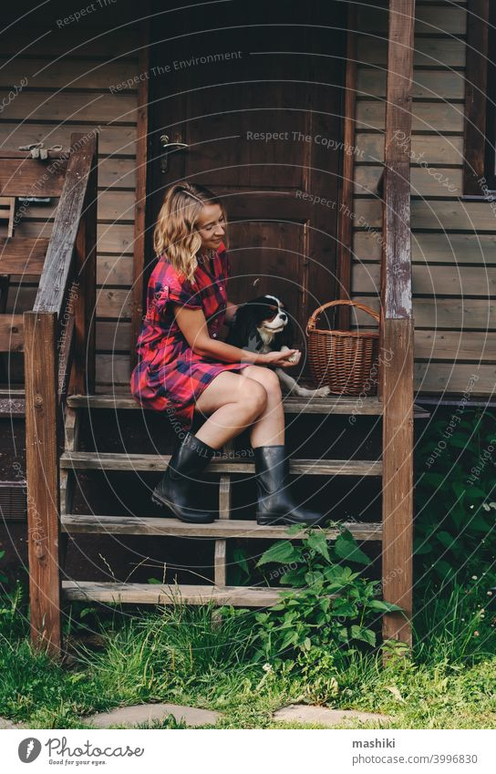 happy woman sitting on porch of her wooden country house. Rural living, running away to nature, ecology concept summer adult female home casual countryside girl