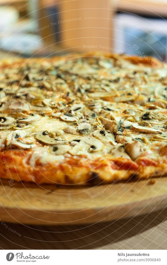 italian pizza with wood plate on bar counter baked cheddar cheese classical closeup cooked crust cuisine delicious dinner dough fast food fresh gourmet greasy