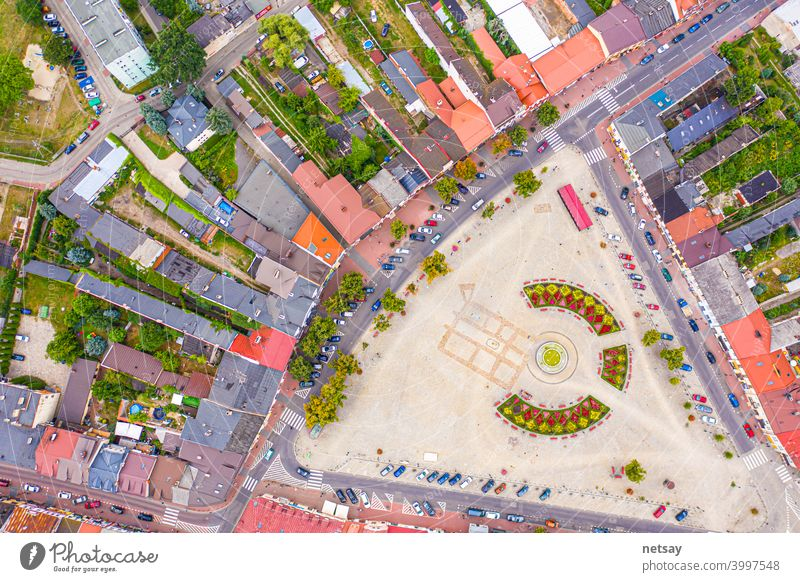Top aerial panoramic view of Lowicz old town historical city centre with Rynek Market Square, Old Town Hall, New City Hall, colorful buildings with multicolored facade and tiled roofs, Poland