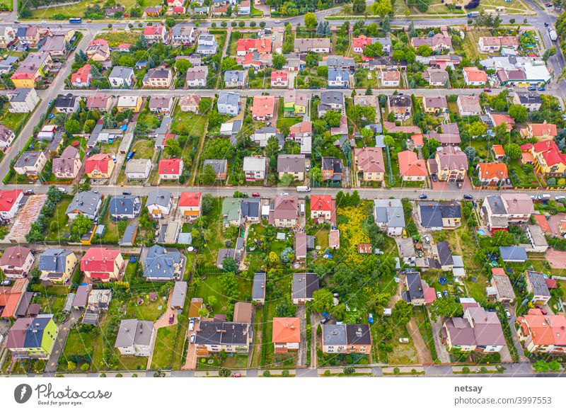 neighborhood with residential houses and driveways, land use planning concept property aerial background survey surveyor view above city road architecture