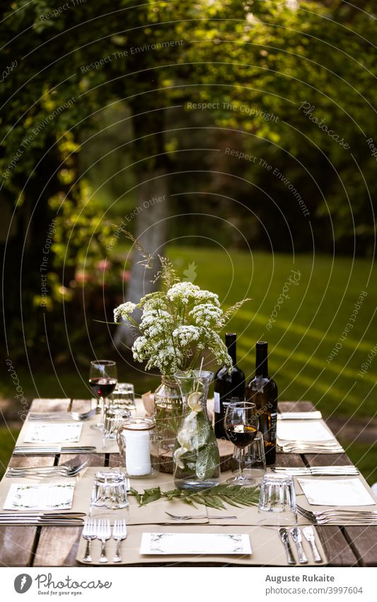 Served restaurant table outdoors Food table Table Restaurant Wine Wine glass wineglass Wine tasting Watering can Fork knife Glass Glassbottle Flowers and plants