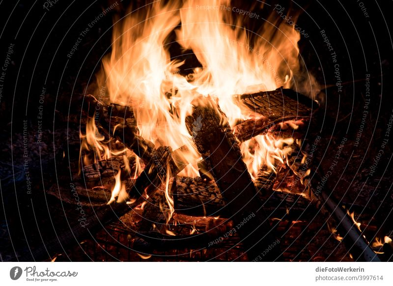 Burning campfire Dark colors Fire Photography Contents Nature Brown Black Night Light Yellow Hot Warmth Orange Fireplace Deserted Embers Wood Incandescent Spark