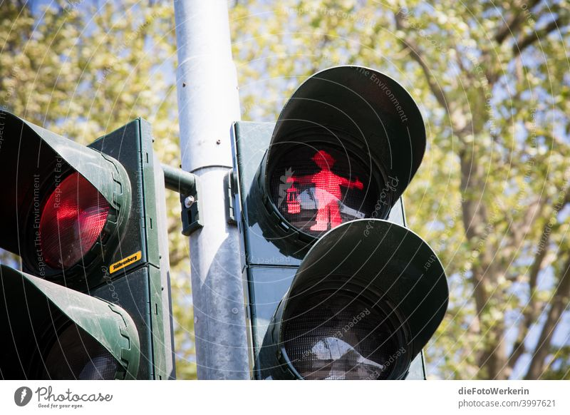 Freeze - red pit man on a traffic light Traffic light Mining colors Photography unsaturated Gray Red Colour photo Exterior shot Day Deserted Transport Road sign
