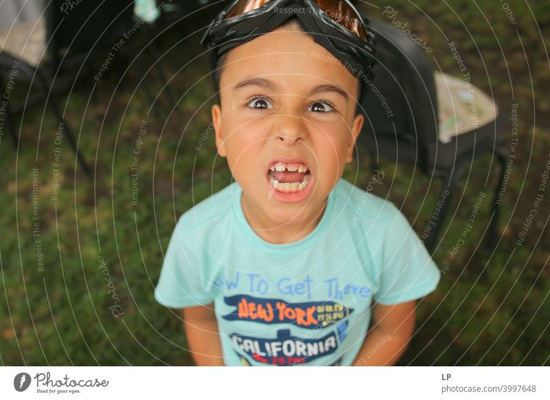 Angry child showing teeth at the camera Looking into the camera Front view Upper body Portrait photograph Dentist Teeth Self-confident Euphoria Anticipation