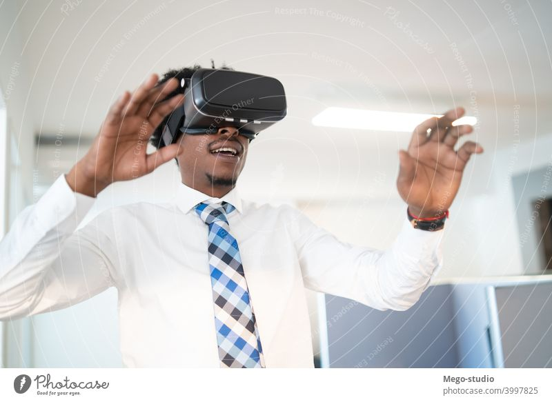 Businessman using VR glasses. businessman vr virtual reality headset concept indoors entertainment equipment simulation electronic job work company workplace