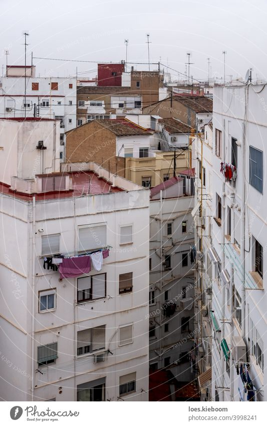 Residential apartement houses overlooking the rooftops in Valencia, Spain valencia neighborhood cityscape architecture construction white mediterranean spain