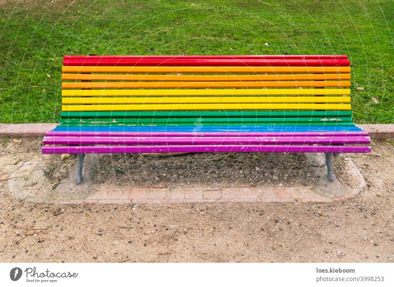 Colorful lgbt rainbow painted bench in a park in Valencia, Spain icon love pattern vintage banner colorful pride flag lesbian community homosexual transgender