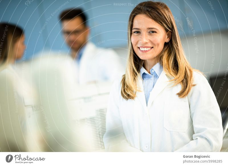 Female scientist in white lab coat standing in the biomedical lab female woman research professional worker biology science technician biotechnology physician