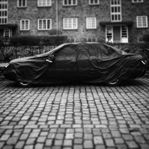 magic hood car Hide Settlement Transport Car Vehicle Means of transport Exterior shot Road traffic Street Deserted Traffic infrastructure Paving stone Parking