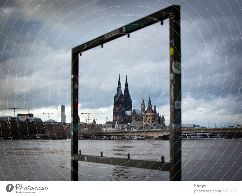 framed Cologne Cathedral . Rhine at high water Central Flood Rhine flood dramatic sky Landmark Tourist Attraction River Downtown Bridge Vista Dome Evening