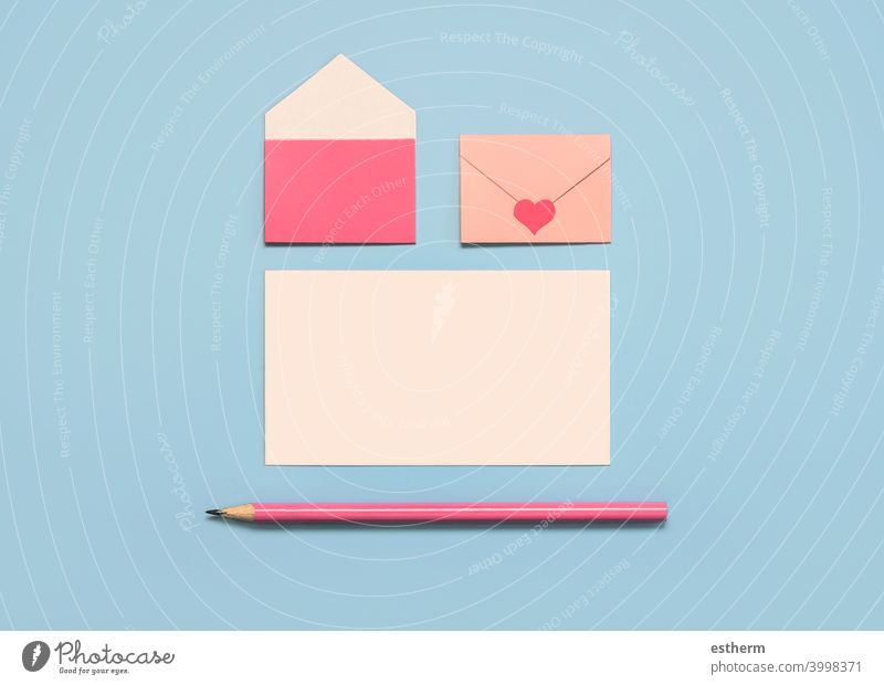 Happy Valentine's Day.Paper envelopes with white card and pink pencil valentine's day love heart valentine background copyspace lovely i love you valentines