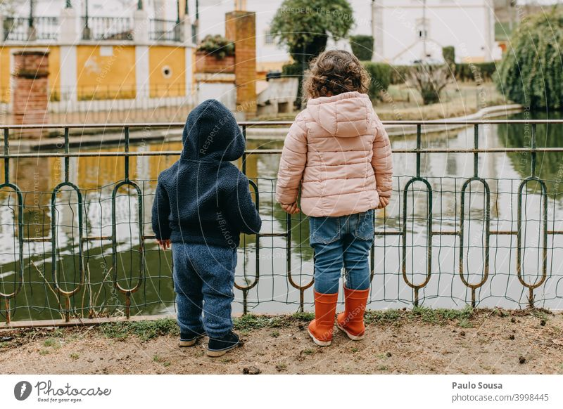 Brother and sister watching lake Brothers and sisters brothers Family & Relations Rear view Unrecognizable Authentic casual Together Friendship Colour photo