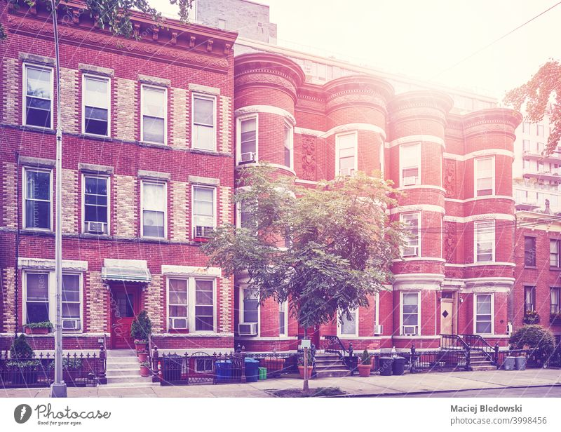 Retro toned picture of townhouses in Brooklyn New York, USA. street city building apartment retro vintage window neighborhood filtered pavement sidewalk empty