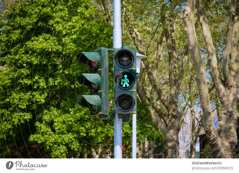 Walking - green pit man on a traffic light Traffic light Mining colors Gray Green Exterior shot Colour photo Day Deserted Town Street Traffic infrastructure