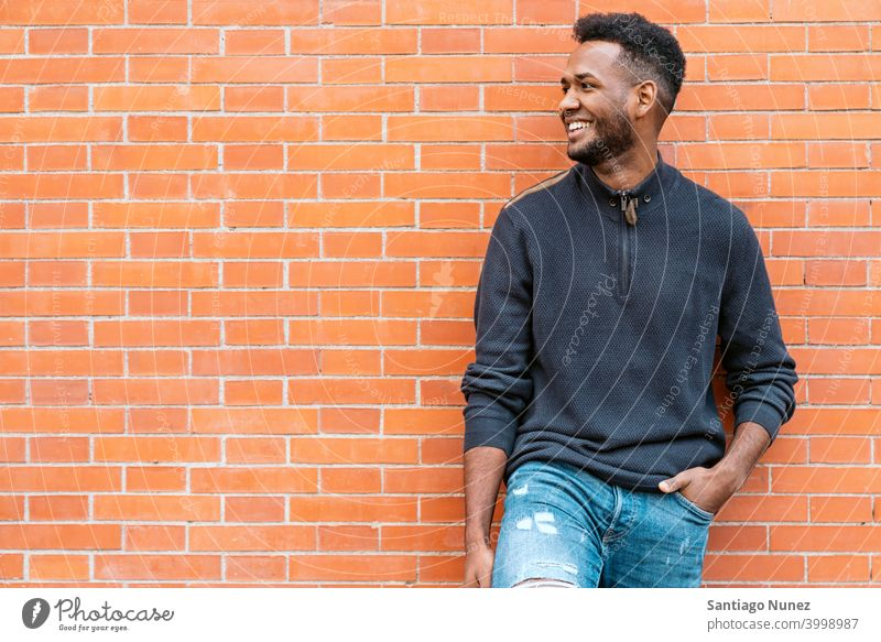 Portrait of Happy of Black Man front view portrait black afro african american one person street outside pose smiling smile fun look looking posing