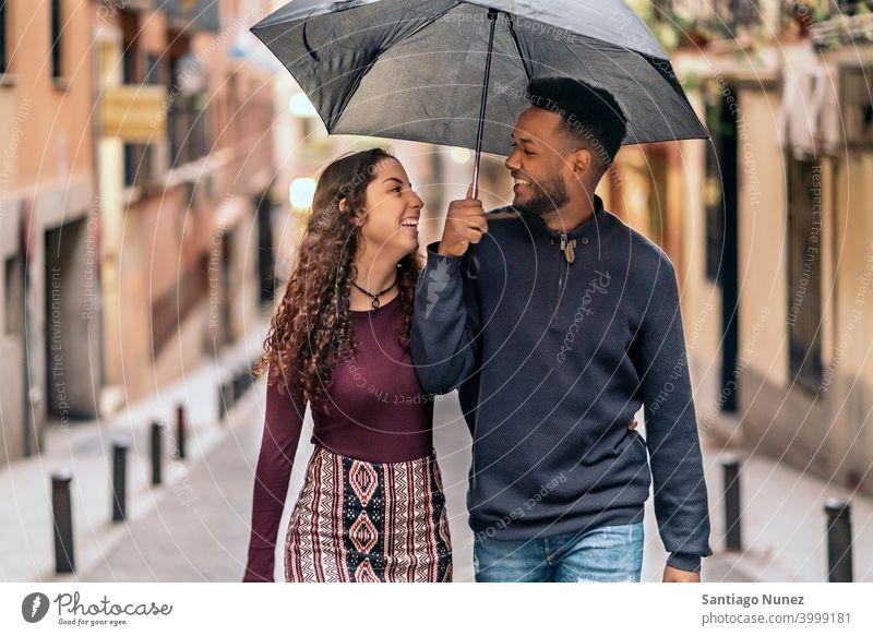 Interracial Couple Having Fun street interracial couple black afro african american diversity relationship multi-racial black man ethnic multi-cultural