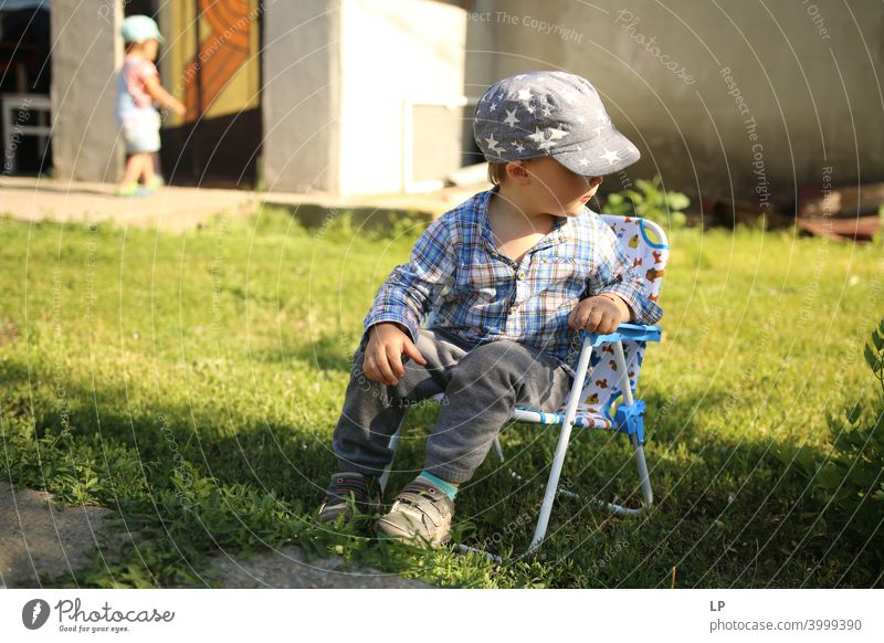 happy child resting and sitting down on a chair looking away Relaxation Communication Body language amusing Entertainment Childhood memory real people growth