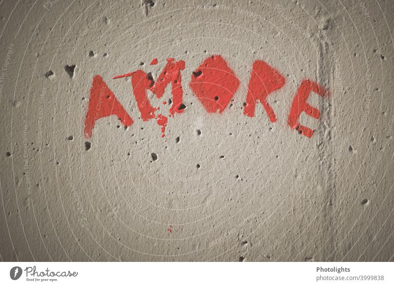 On one wall the word Amore is written amore Love Red Wall (building) Graffiti Colour photo Exterior shot Wall (barrier) Infatuation Emotions Romance Deserted