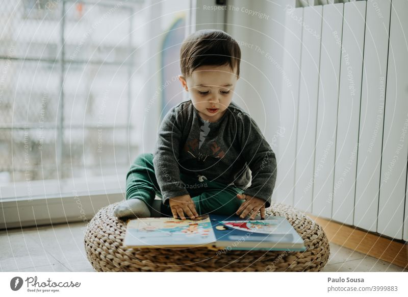 Toddler reading a book at home Child childhood 0 - 12 months 1 - 3 years Caucasian Reading Book Education educational Joy Happy Cute Lifestyle Human being Baby