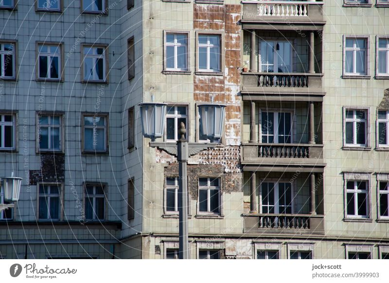 Facade Karl Marx Friedrichshain Classicism Old Balcony Street lighting Historic Authentic Past Decline Nostalgia for former East Germany Ravages of time GDR