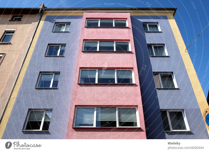 Colourful and contrasting facade in the style of the fifties in front of a blue sky in sunshine in the north end of Frankfurt am Main in Hesse Facade wohhaus