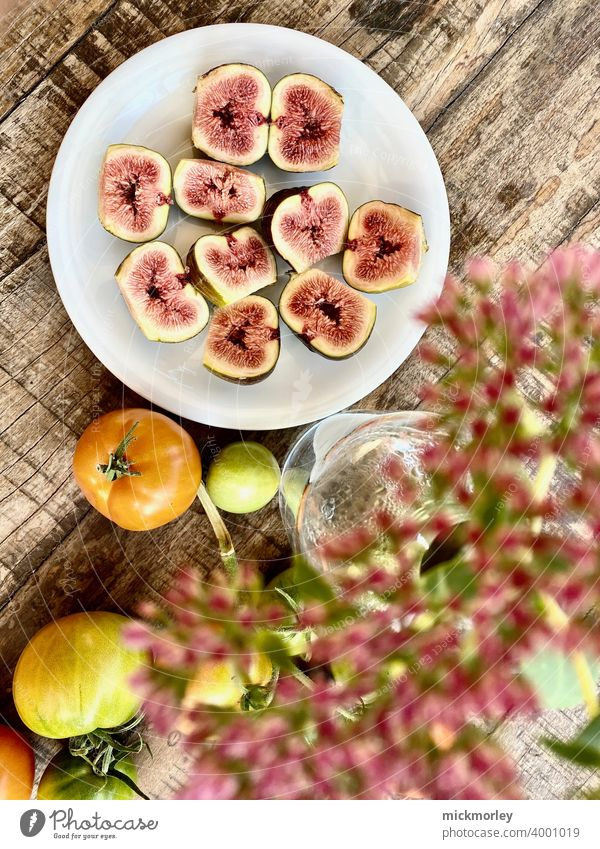 Fresh figs Figs Fruit garden fruit fresh from the summer Wooden table Snack Snackbar Healthy salubriously healthy lifestyle Healthy Eating Tomato tomatoes