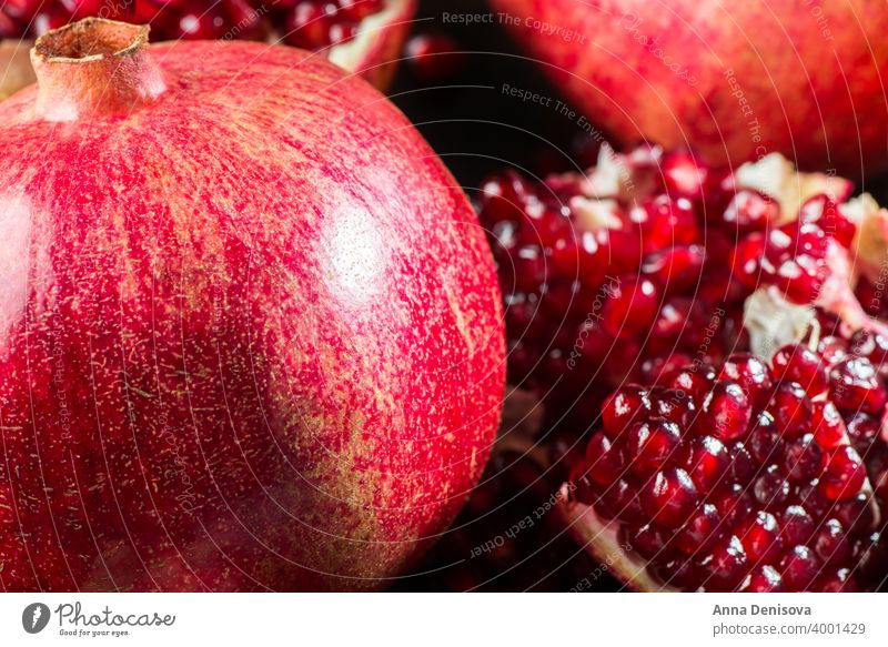 Ripe Open Pomegranate pomegranate background fruit ripe red healthy food organic vegetarian seed juicy fresh half sweet raw nature wooden space slice freshness